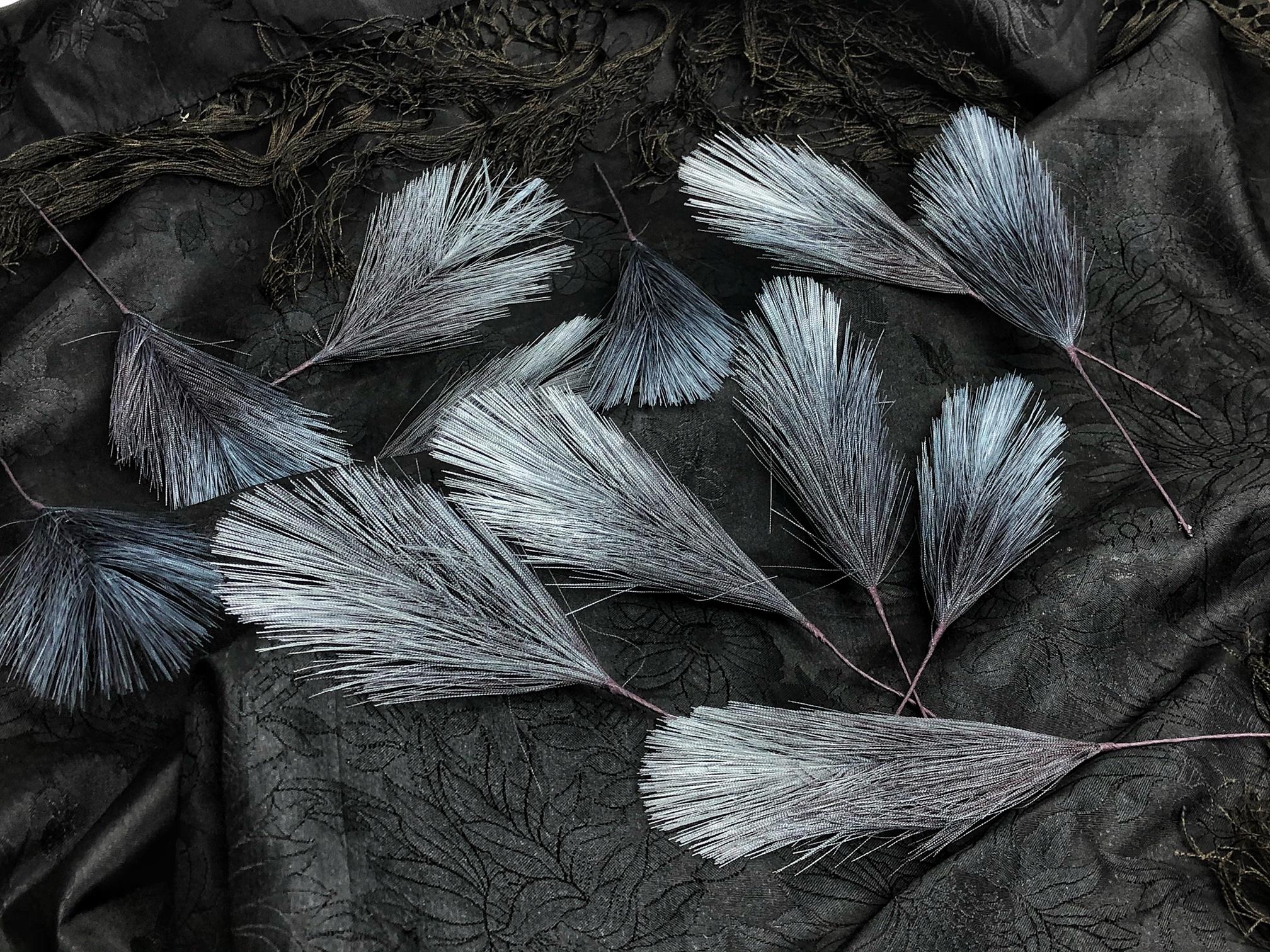 Konstgjorda Fjädrar